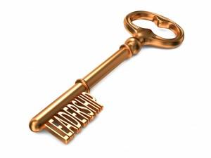 Leadership - Golden Key on White Background. 3D Render. Business Concept.